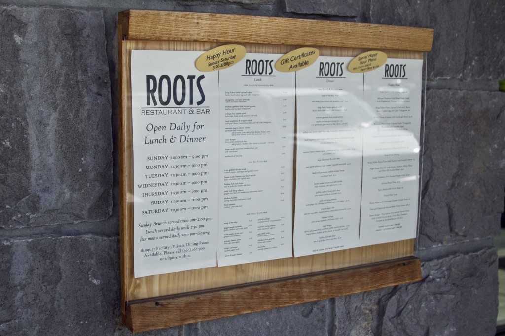 The seasonal menu displayed near the entrance of Roots Restaurant and Bar