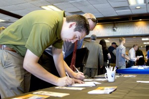 Paul Rush fills out an application at job fair