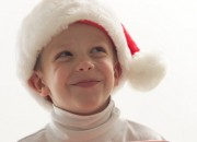 Young boy wearing santa hat