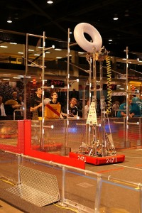FIRST Robotics team members control Wallace, the group's robot, at the Washington state competition on March 18.